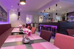 DomLounge im Hotel Caprica am Dom mit einer Auswahl an Kalt- und Heißgetränken und kostenfreiem W-LAN.